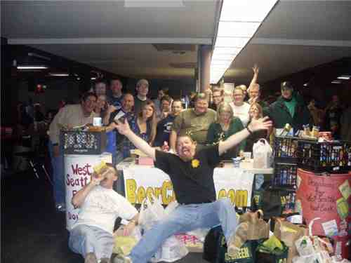 A portion of the crowd poses with a portion of the food.