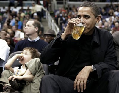 President Obama enjoying a beer at a Washington Wizard's game. Nice to know that even he can't afford to drink good beer at professional sporting events.