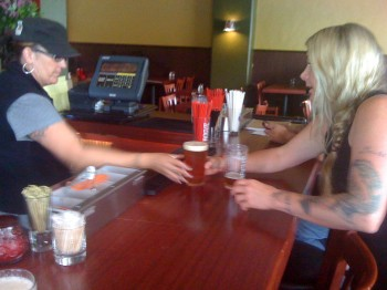 Bartender Jackie serves up one of the first pints at Porterhouse West Seattle.