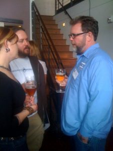 Goose Island brewmaster Greg Hall talks to guests at a special tasting event in Seattle last June. Greg will be stepping down.
