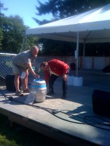 Ceremonial tapping of the first keg by the Mayor of Kenmore.
