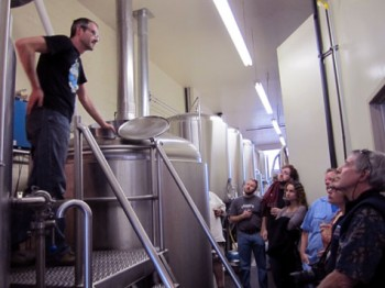 Aaron Jacob Smith leading a brewery tour.