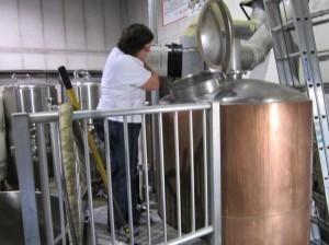 Kim adding hops to the boil.