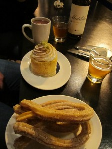 Dessert at XOCO: fresh churros with hot chocolate for dipping; ginger lime leche cake, and Goose Island Matilda.