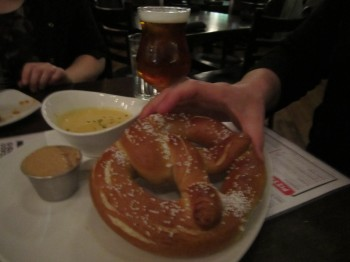 Huge soft pretzel with German-style mustard and creamy cheddar-ale dipping sauce (at Revolution Brewing)