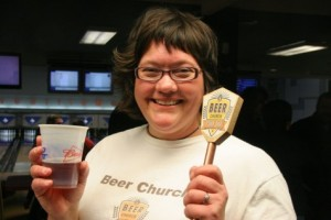 Kim (Mrs. Beer Blog and Mrs. Beer Church) with the tap handle.