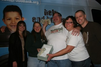 Handing over the cash to the Food Bank.