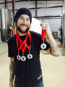 Goodlife's Tennessee Jed, hoists medals from the Best of Craft Beer Awards. Photo shamelessly pinched from Goodlife's Facebook page.
