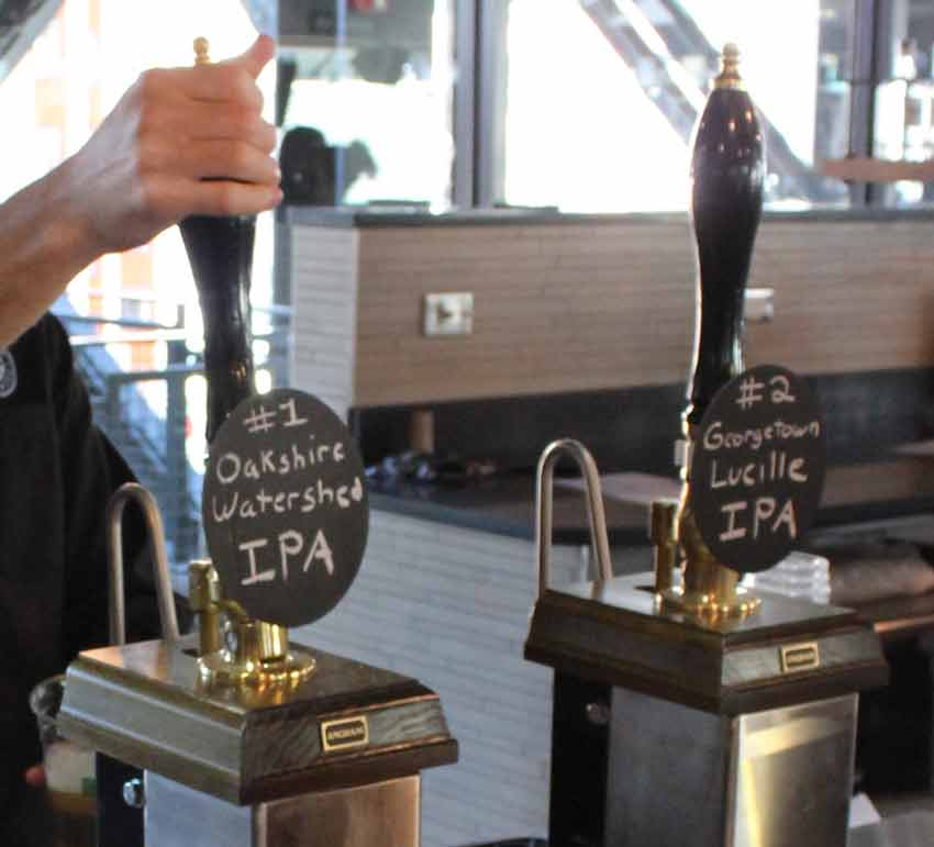 """Cask beer poured to in the traditional manner. From a """"beer engine."""""""