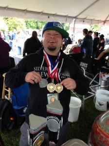 Kurt Larson shows off Silver City Brewing's medals.