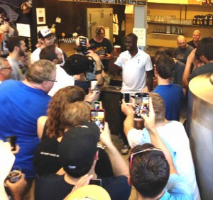 Tottenhan superstar Ledley King hoists a pint with the crowd.