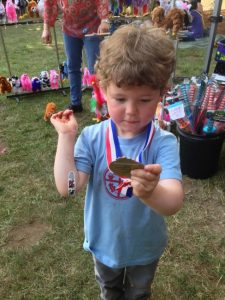 Reuben showing off some of daddy's medals at the 2013 Washington Brewers Festival.