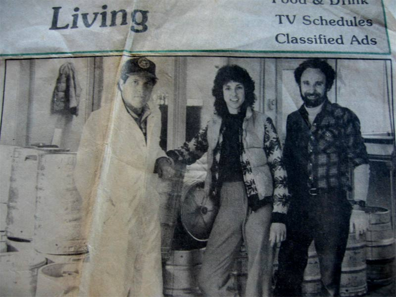 Historic newspaper clipping: Thomas Kemper Brewing (let ot right: Andy Thomas, Mari Kemper, Will Kemper.) Photo from chuckanutbreweryandkitchen.com.