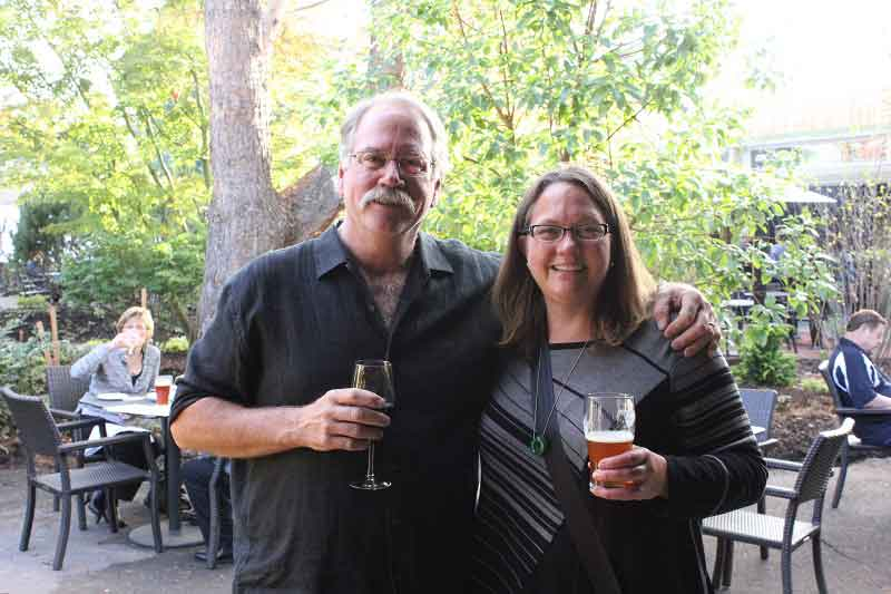 Brian McMenamin and Kim palling around at last year's grand opening.