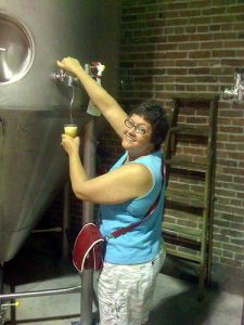 Sampling a beer from a zwickel at Alpine Brewing, circa 2009.