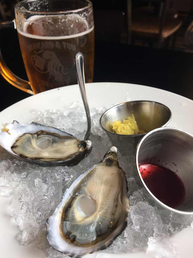 Oysters are one of the specialties here. Pictured, two Shigoku oysters, served with lemon zest and a lovely Huckleberry Mignonette, which is made with Pike Brewing's Monk's Uncle.