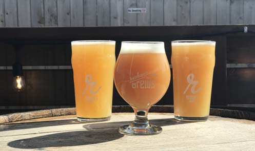 Three hazy beers from Reuben's Brews. Photo via Reuben's Brews.