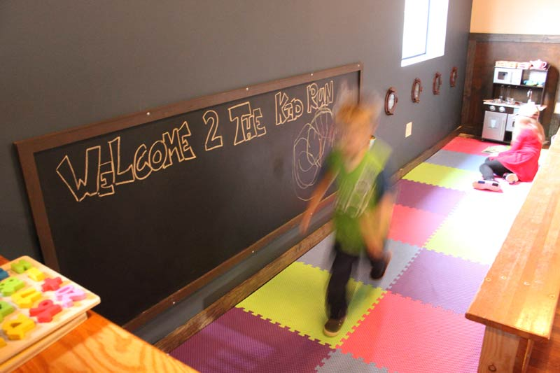 Upstairs, the taproom includes a designated play space for kids.