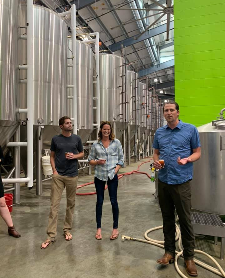 Left to Right: Kevin Smith, Meghann Quinn, and Kevin Quinn lead a tour of the brewery.