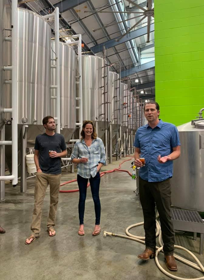 Left to Right: Kevin Smith, Meghann Quinn, and Kevin Quinn lead a tour of their brewery. (Photo by Kim Sharpe Jones.)