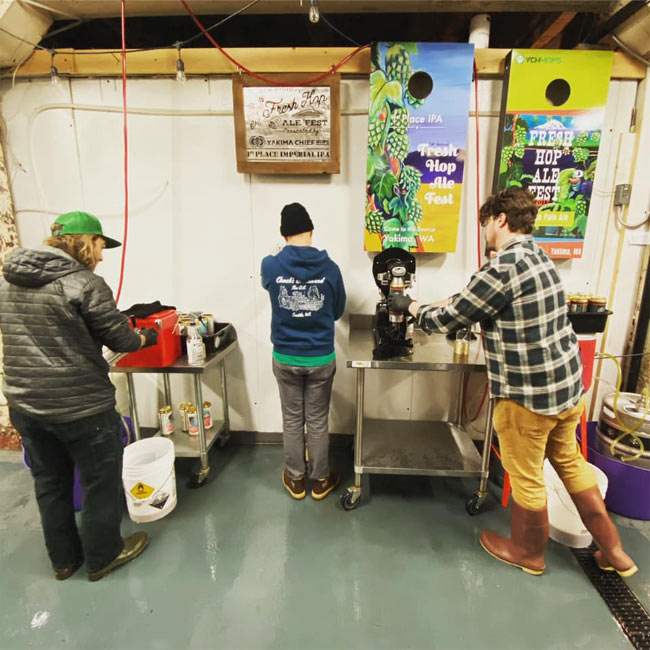 The crew at Cloudburst Brewing pre-filling crowlers to speed thing up for customers to move along. From Facebook.