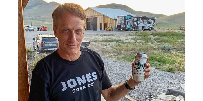 Skateboarding legend Tony Hawk with a can of beer from Seapine Brewing.